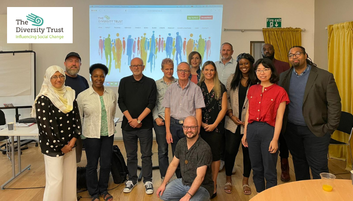 Image shows many of the Diversity Team members gathered for the AGM